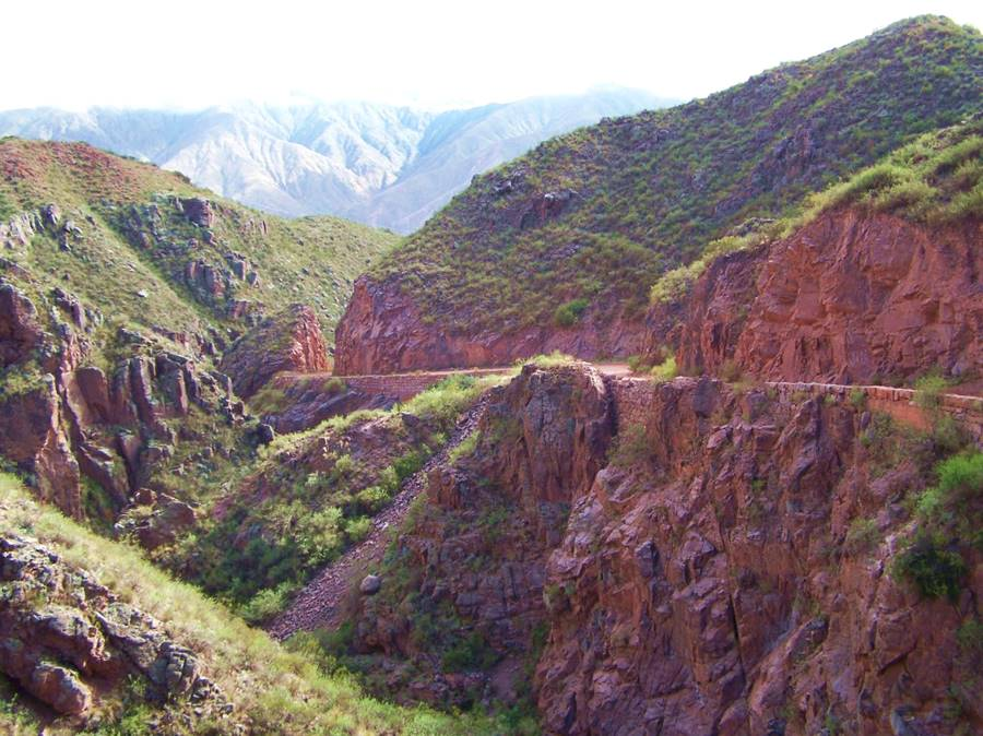 The steep red scenery on the preserved segment of the old Cuesta de Miranda
