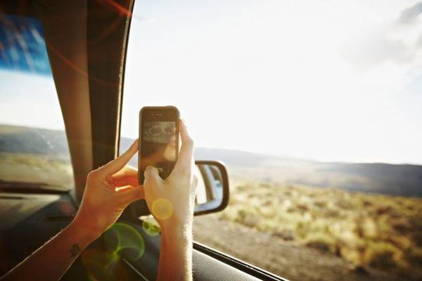 photographing scenery from a moving car