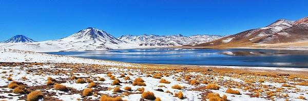 View of lake and snow-capped volcanoes in Atacama, Chile